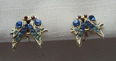 Vintage gold tone screw back pair of dove earrings with rhinestones