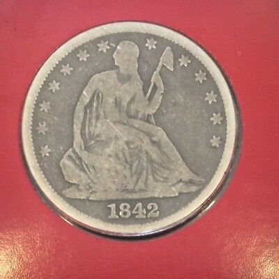 1842 Seated Liberty Half Dollar Good Condition - in promotional card