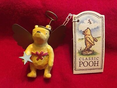 Disney Classic Pooh holding gold star Pooh Ornament