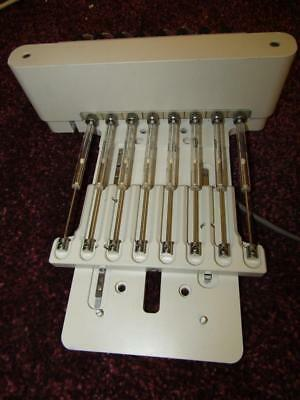 Block Of 8 Syringes With Linear Slides.