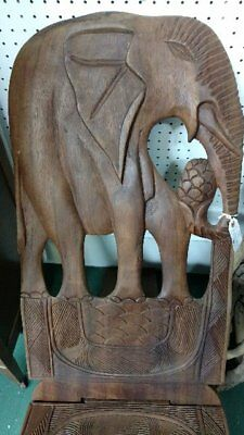 Hand carved two piece African birthing chair with elephant figure