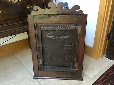 Georgian Rustic Carved Oak Hanging Corner Cupboard dating from late 18thC