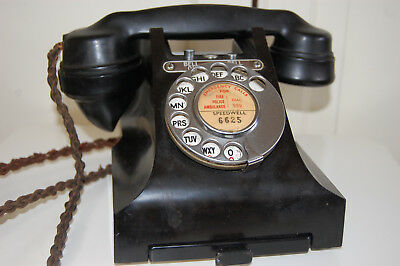 GPO black bakelite 328L bell on/off model telephone with drawer. 1950's.