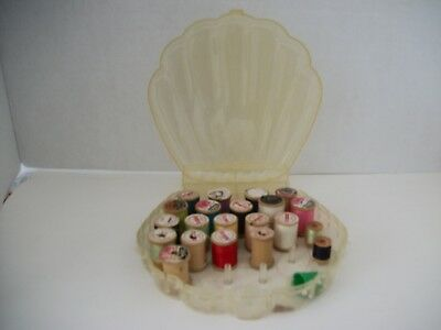 VINTAGE SHELL SHAPED CLEAR PLASTIC SEWING BOX with 21 WOODEN SPOOLS