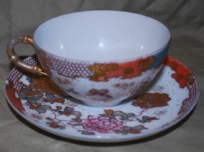 Vintage Japanese Kutani porcelain cup and saucer. butterflies and peonies