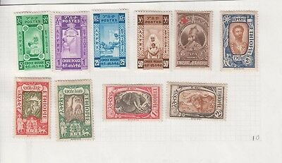 Ethiopia 1919 lot 10 mint hinged stamps on page.Red Cross, animals + Emperor