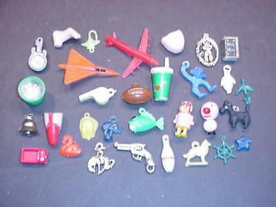 Thirty one 1960's Vending charms and Misc items