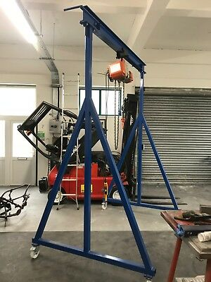1 Ton gantry and .5 ton electric hoist.