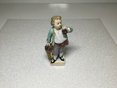 Meissen Small Boy in Blue Coat Holding Bunch of Grapes Figurine