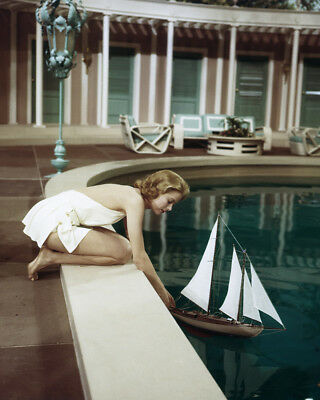 High Society Grace Kelly in white swimsuit putting toy yacht in pool 8X10 Photo