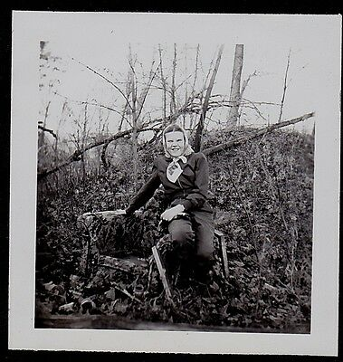 Old Vintage Antique Photograph of a Woman Sitting on an Armchair in the Woods