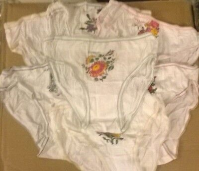 7 pairs of girls knickers, white with flower, Mon to Sunday NEW. Bargain.