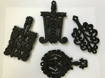 "Set of Four 5""Cast Iron Trivets three stamped Wilton one looks to be mis-stamped"