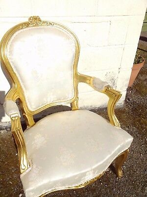 Gold coloured French style arm chair