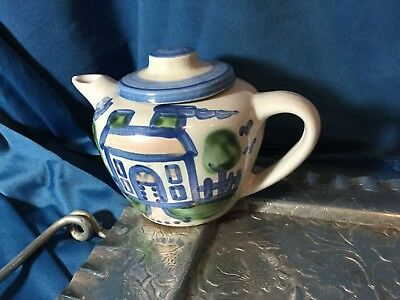 Hadley pottery small teapot with a house design