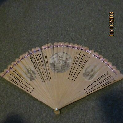 antique sandalwood fan with cut-out slats and paper litho scenes and signature
