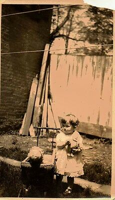 Old Antique Vintage Photograph Little Girl Playing With Her Dolls in Carriage