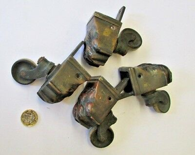 """Set of 4 Antique Brass Lions paw  castors, 2.1/2 """"long, in  used condition."""