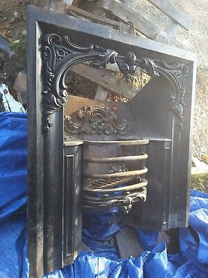 vintage cast iron fireplace insert, in need of restoration