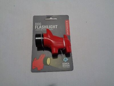 New on card red plastic scottie shaped flashlight with batteries nose lites up