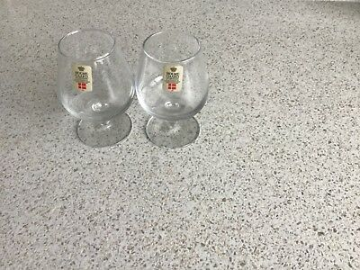 Two Holmegaard,small spitits glasses,9cm tall, original label on glass x con