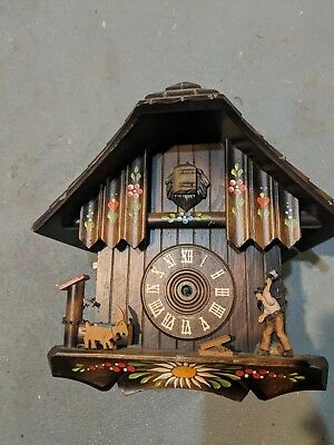 Antique Black Forest Cuckoo Woodcutter and Edelweiss Chateau Wood Bird