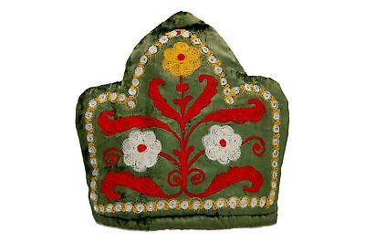 A hand emboidered tea cosy