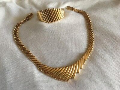 So 1980's gold tone fully hinged retro necklace and matching cuff bracelet.