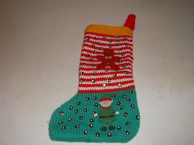 christmas colours hand knitted christmas stocking