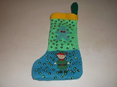 blue, green and yellow hand knitted christmas stocking