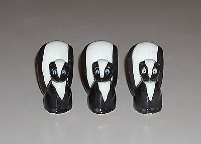 Vintage Skunk Figurine Trio with Blue Eyes Ceramic Three 3 All Different