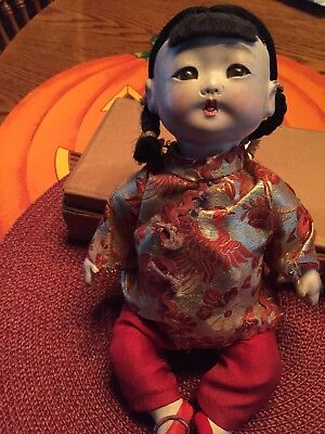 Antique  composition oriental Girl doll with glass eyes Talker
