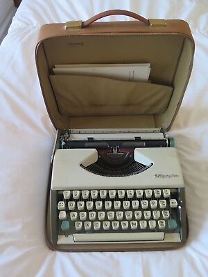 Vintage (1960) Olympia De Luxe Portable Travel Typewriter in Leather Case.