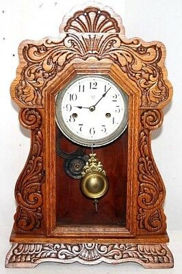 Antique Tall Carved Oak Waterbury Gingerbread Clock W/ Pressed Scrolled Designs.