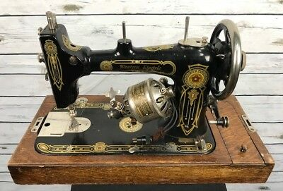 Vintage Sewing machine with wooden oval case RARE antique Western Electric