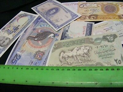Lot of 13 uncirculated World Banknotes, all diff..Please see photos.