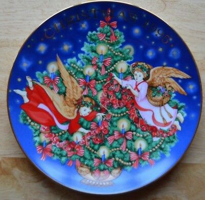 "Avon 1995 Christmas Plate ""Trimming the Tree""  Porcelain with 22K gold"