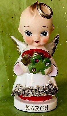 Vintage ARNART Kewpie MARCH Angel Holding Three Leaf Clover With Jewels