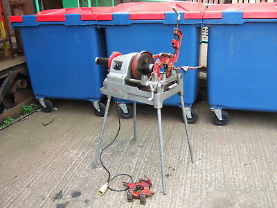 """110v  self oiling pipe threader on stand. Threads 1/2"""" up to 3"""" diameter pipe."""