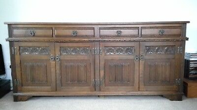 antique oak carved sideboard, Old Charm,made by Wood Brothers.4doors and drawers