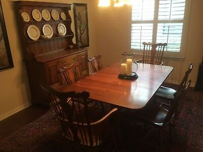 antique Stickley dining room table with matching hutch