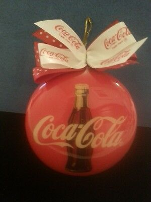 Coca Cola Christmas Tree Ornament. Round with bow on top.