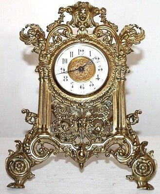Antique French Richly Decorated Brass Strut Desk Clock W/ Porcelain Dial & Putti