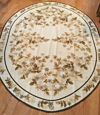 Table cloth, oval with brown flowers, 80x 60 inches, & 6 napkins 19.5 x 19.5