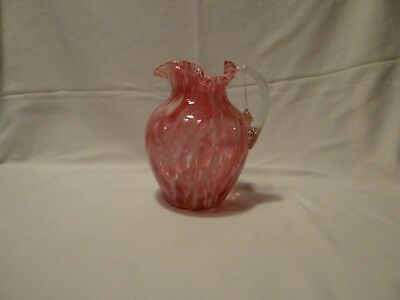 Art glass antique pitcher blown pink spatter with rippled clear glass handle