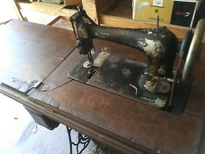 Vintage Singer Treadle Sewing Machine Model H335482 in Cabinet