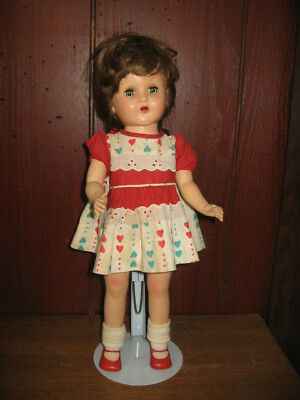 Hard plastic girl doll from the 1950's