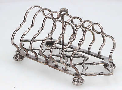 An old English silverplated toast rack Signed J.G 6 holder