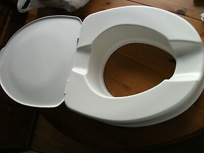 "4"" RAISED TOILET SEAT WITH LID by DRIVE MEDICAL LTD  excellent condition BOXED"