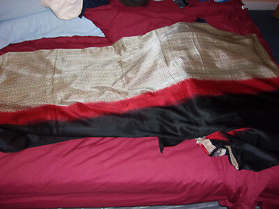 Black, red and gold saree